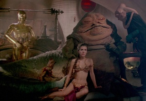 The enormous Jabba, alongside his servants, his new slave, and a prissy droid.